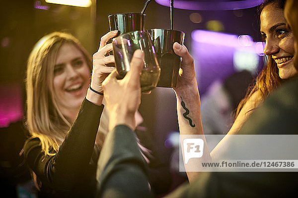 Friends making celebratory toast at nightclub
