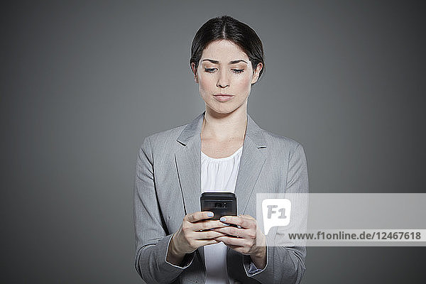 Portrait of young woman text messaging.