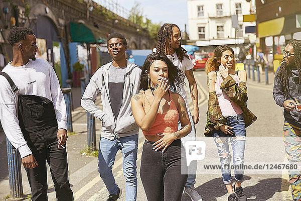 Friends walking along street