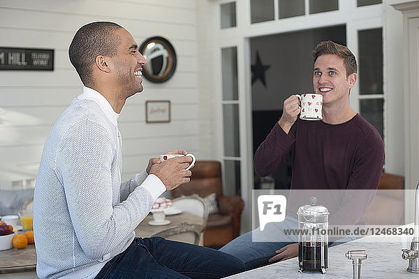 Young men drinking coffee