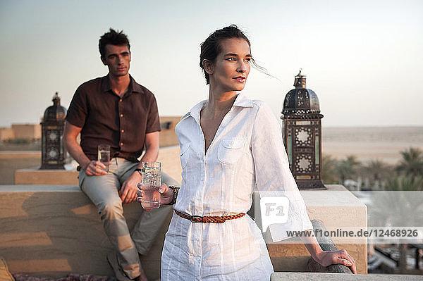 Couple drinking on balcony in Dubai  United Arab Emirates