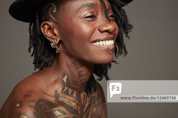 Smiling young woman with tattoos