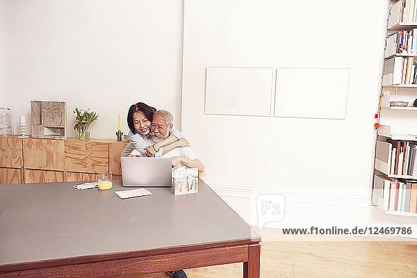 Senior couple enjoying video conference on laptop