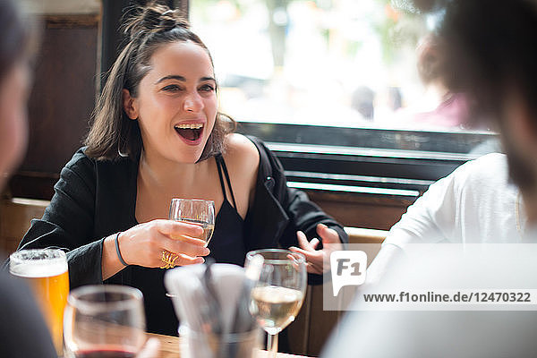 Young woman with friends at bar