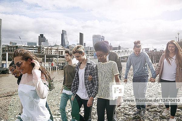 Teenagers walking on riverbank