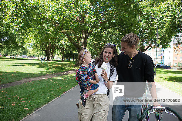 Family with bicycle in park