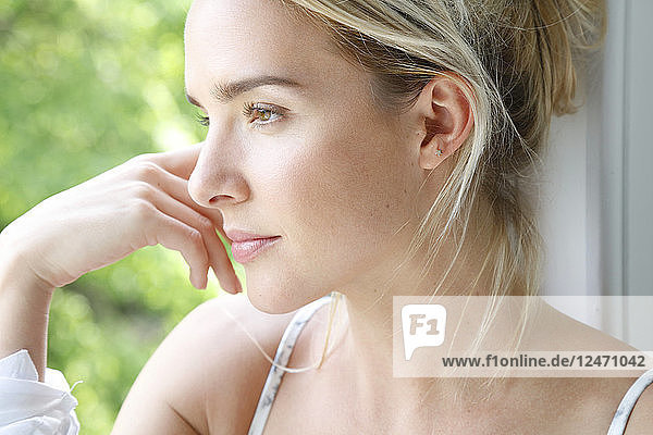 Young woman beside window