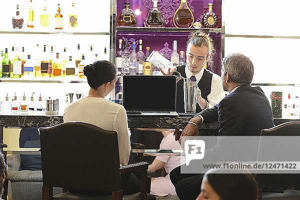 Businesspeople in meeting at bar