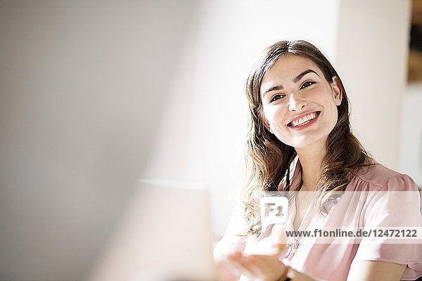 Young businesswoman smiling during meeting in office