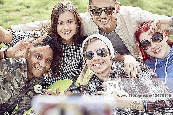Teenage friends taking selfie at park