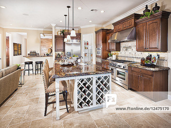 Brown kitchen with stools