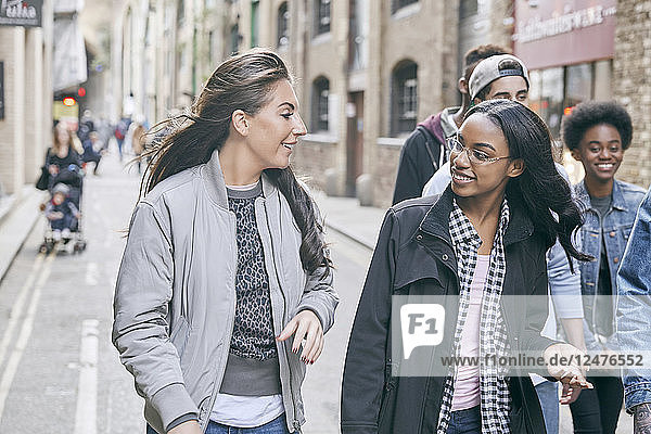 Teenagers walking through an alley