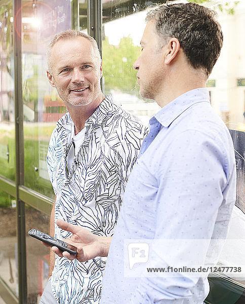 Gay couple using smart phone
