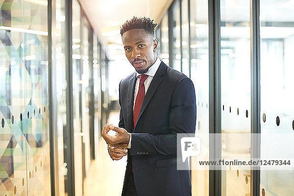 Portrait of young businessman wearing suit