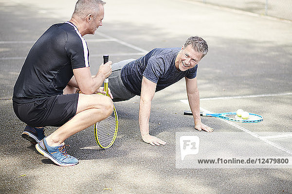 Mature men doing push-ups