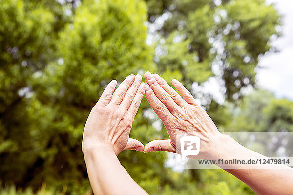 Women touching hands during exercise class, Women touching hands during exercise class