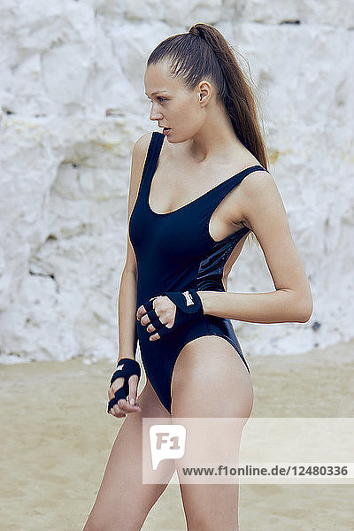 Young woman in one piece swimsuit