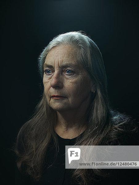 Portrait of senior woman in shadow