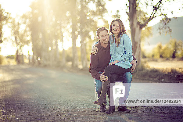 Couple smiling on road