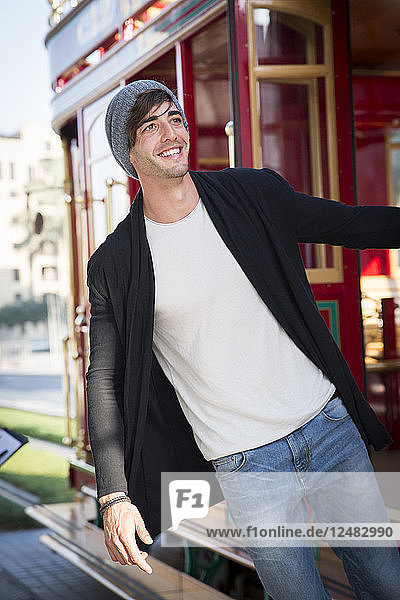 Young man smiling on tram