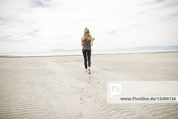 A Young Woman Walking In The Desert