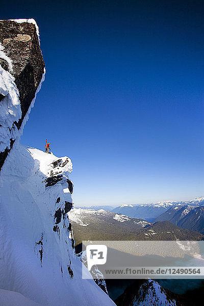 Drew Tabke Standing On Top Of Cascade Mountains In Washington