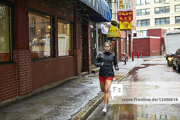 Young Asian Girls Running Through The Wet Streets Of Boston