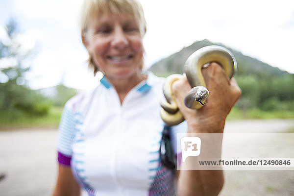A woman holds a Rubber Boa Snake found in the road in Montana