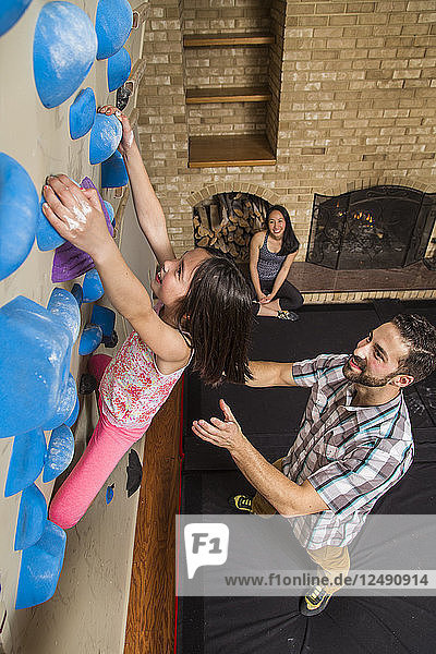 Family Playing With Climbing Gym In Their House