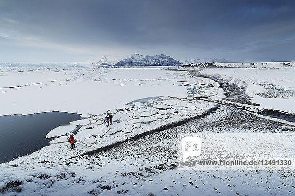 Three Photographers On Snowy Landscape In Jokulsarlon  Iceland
