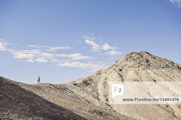 A Hiker Descends A Peak At Desolation Canyon Trail  Death Valley National Park  California