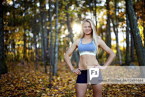 A Female Athlete Standing In The Forest
