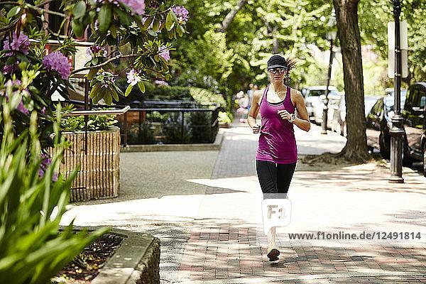 A Woman Running In The Back Bay Neighborhood Of Boston