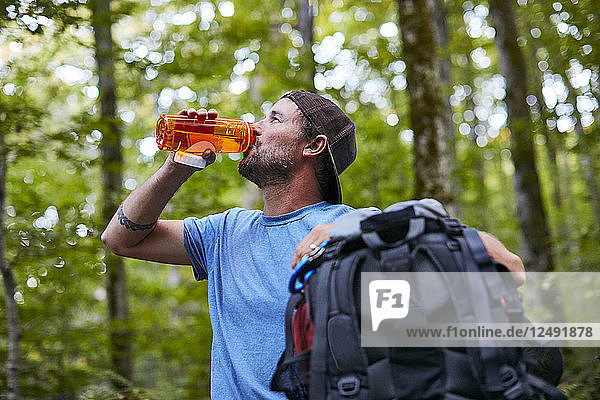 A Man Drinking Water While Hiking Along The Appalachian Trail