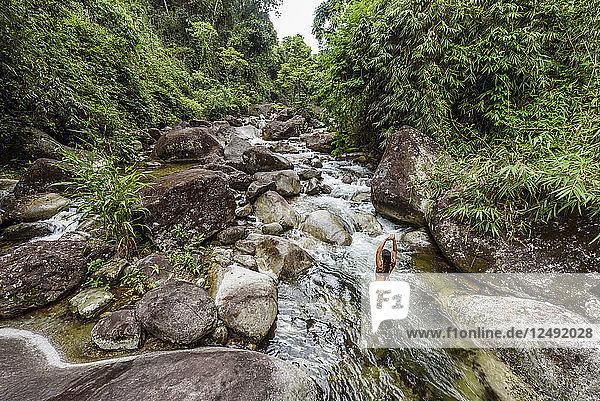 Woman in Santo Antonio River  Serrinha do Alambari  Rio de Janeiro  Brazil