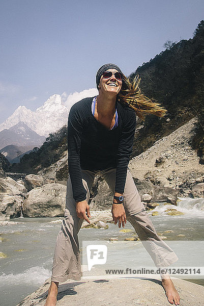 A Woman Smiles Trailside On The Way To Everest Base Camp