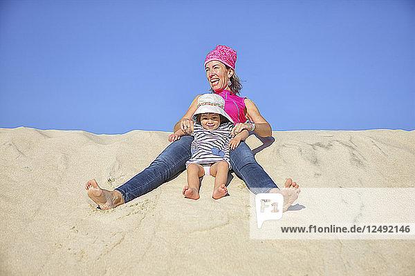 mother playing on the beach sand dunes Sa?? Jacinto