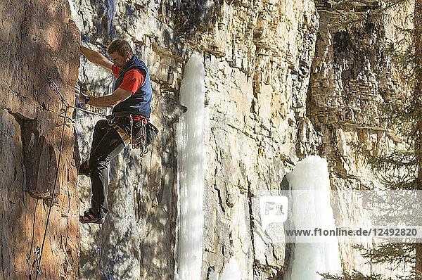 A man rock climbing on a winter's day  Cascade Canyon  San Juan National Forest  Durango  Colorado.