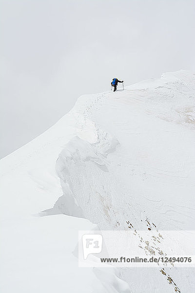 A man climbing Lizard Head Peak in the Lizard Head Wilderness  Uncompahgre National Forest  Telluride  Colorado.
