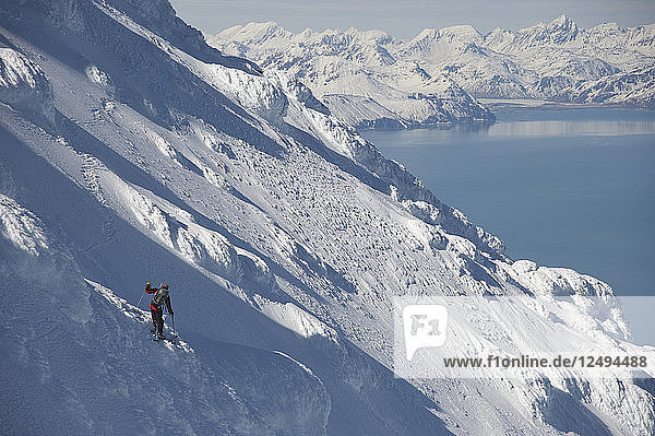 Skiers Descend From The Summit Of Mount Augustine  Alaska  Usa