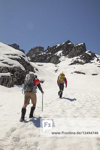 Two climbers approach Trio Peak in British Columbia  Canada.