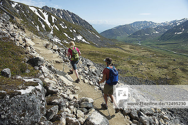 Hikers on the trail to Gold Cord Lake in Independence Mine State Historical Park at Hatcher Pass  Alaska June 2011. The half-mile trail leads to an alpine lake above the historic gold mine near Hatcher Pass.