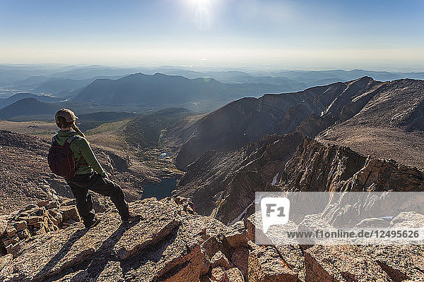 Hiker Looking Down From The Top Of Longs Peak In Colorado