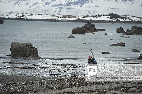 Skier On The Coast Of Augustine Island  Alaska  Usa