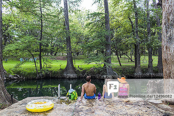 The Blue Hole in Wimberley  Texas is a popular destination for tourists and locals on hot summer days. The clear  cool water flows through cypress trees and offers a refuge from the Texas heat.
