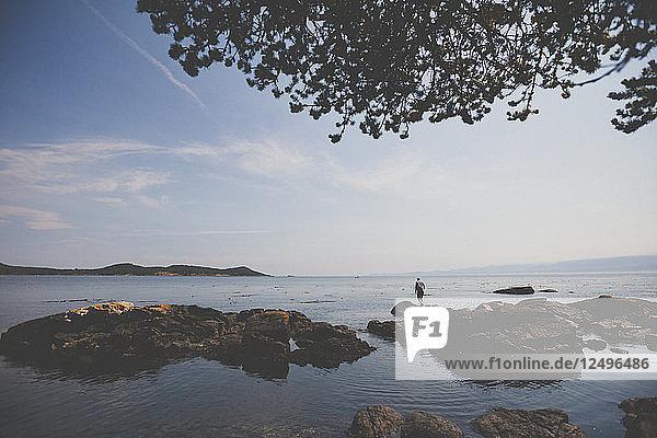 A man explores the edge of Vancouver Island near Sooke  B.C.