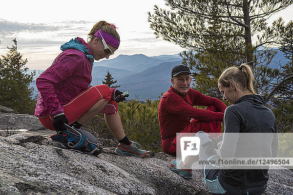 Kristina Folcik  Bob Najar and Leslie O'Dell stop to enjoy teh wide open views on top of Black Cap Mt.