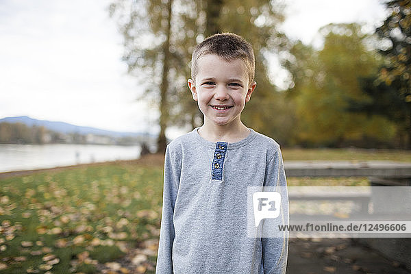 Portrait Of A Smiling Young Boy At Park