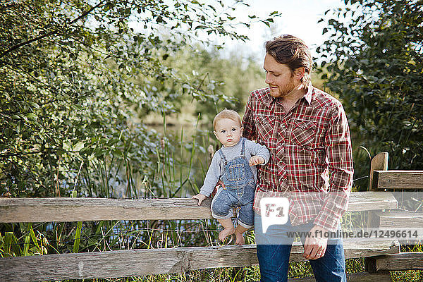 Outdoor portrait of a father with his baby.