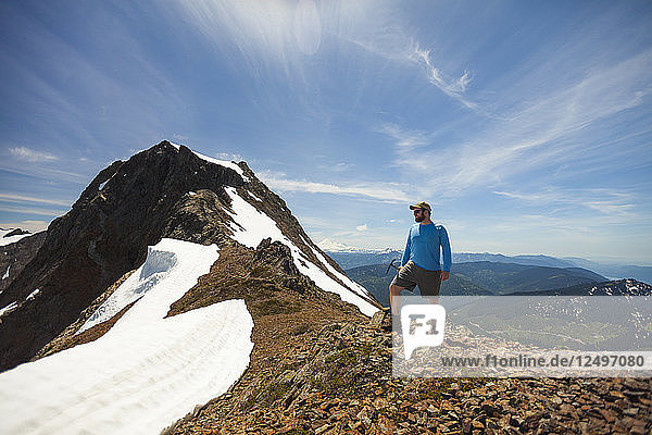 Hiker standing on mountain in Cheam Mountain Range